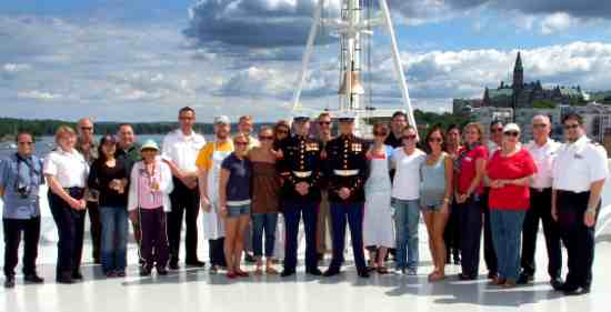 The American crew pose with two United States Marines.