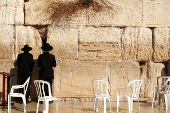 Two pilgrims pray at the Western Wall.