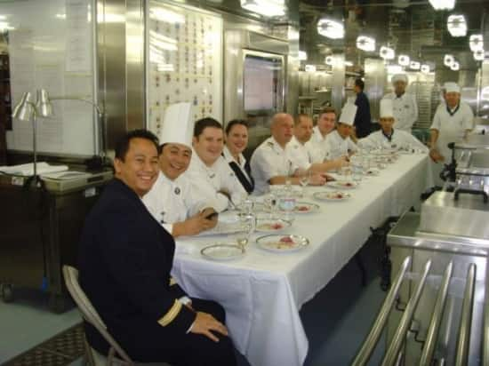 Eurodam officers and key kitchen personnel test-tasting Batronil's five-course meal.
