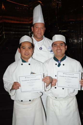 Executive Chef Robert Schumann (center) with Marlon and Roy.