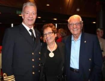 From left: Captain Jonathan Mercer poses for a picture with suite guests Ronald Evans and Cheri Smith-Evans.