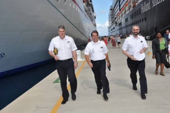 Captain Darin Bowland, Hotel Manager Marco van Belleghem and Chief Engineer Frank de Vries in front of Eurodam and next to the Carnival Miracle.