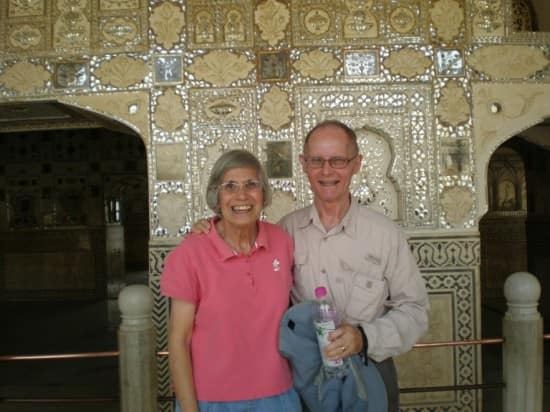 Georgina and Humberto standing in front of arches of Amber Palace in Jaipur.