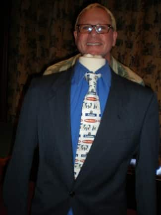 Cruise director Bruce sports a Holland America tie you can win with Grand Dollars.