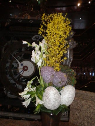 Floral arrangement with lilies and egg decorations in the Promenade Deck Atrium of the Amsterdam.