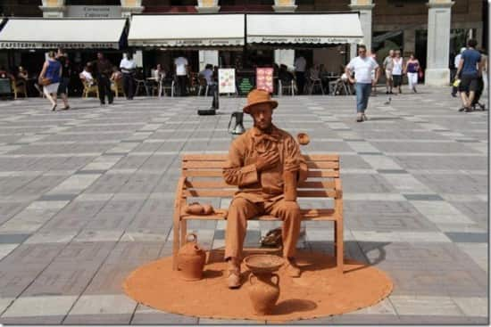 Makes you wonder how they manage to sit there all day long in extremely hot temperatures. Real human works of art.