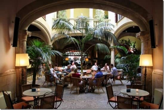 """We found a lovely coffee restaurant named """"Cappuccino"""""""" built on the inside square of a casa (Spanish house). An oasis for rest in the middle of town, and a coffee to return for."""