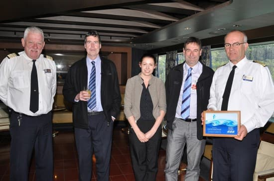 Hotel Director Robert Versteeg on the far left and Captain Henk Draper on the far right holding the plaque.