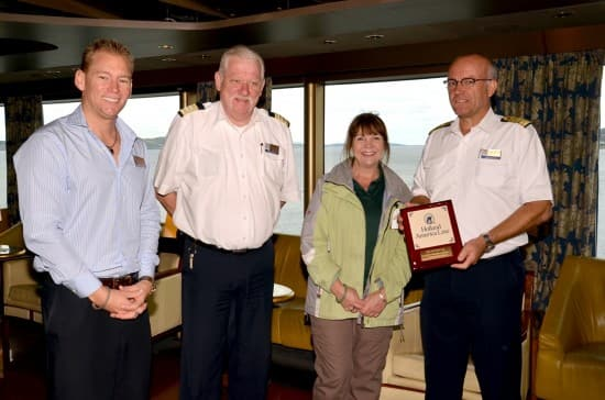 From left: Cruise Director Drew Smith, Hotel Director Robert Versteeg, local official from Hobart, Tasmania, Australia and Captain Henk Draper.