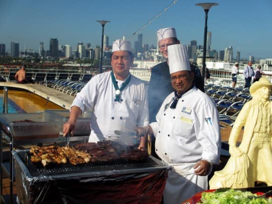Cooking crocodile and kangaroo meat with a view of Melbourne skyline