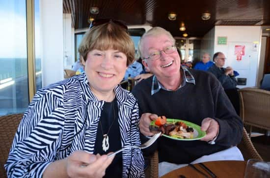 Me and Larry Campbell (a friend from Rotterdam Cruise to Hawaii and Tahiti) eating kangaroo and crocodile.