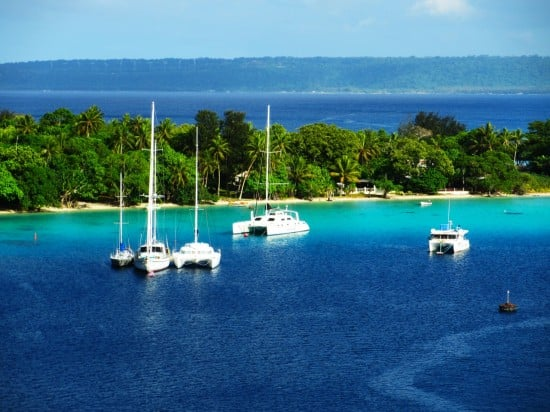 Catamarans and sailboats at Port Vila as seen from the Volendam.