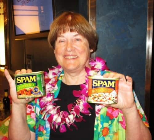 Wearing the lei I made and holding two kinds of SPAM.