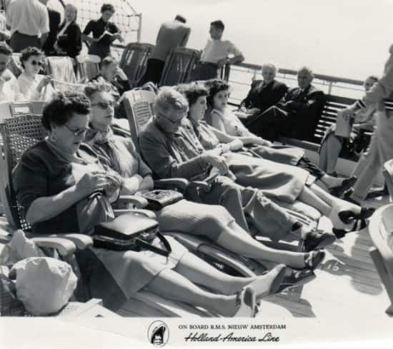 Dorothy Goldman is second from the left relaxing with other passengers on deck.