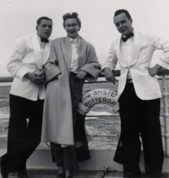 Dorothy Goldman is shown with two crew members, perhaps from the dining room.