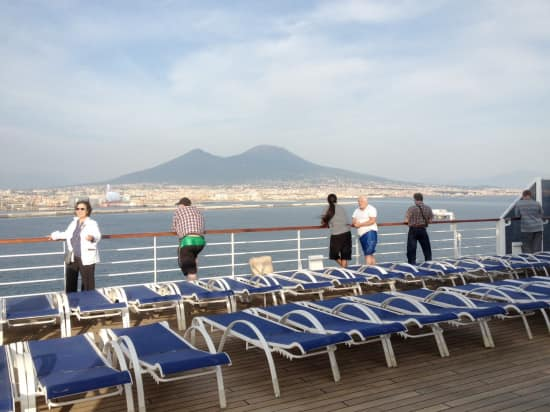 Mount Vesuvius during a sailaway moment under blue skies out of Naples.