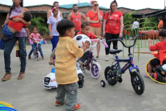 Veendam crew donates toys, bikes and games to Manta's young, little students.
