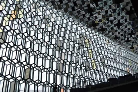 Harpa's glass façade from the inside – again, with seating alcoves along the stairway.