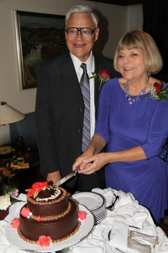 Tom and Mary cut the cake.