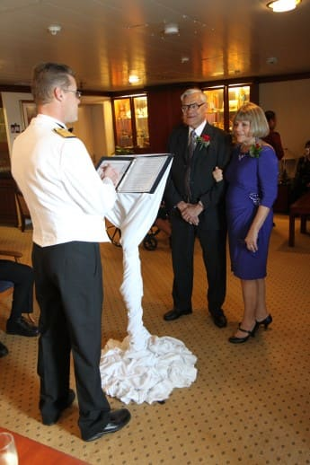 Captain Andre officiates the vow renewal.
