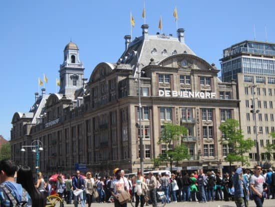 The Bijenkorf department store on a crowded Dam Square