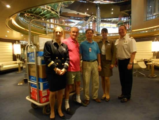 Jody Becker, Rose Robles and Joe Reina of Holland America Line presenting boxes to charity