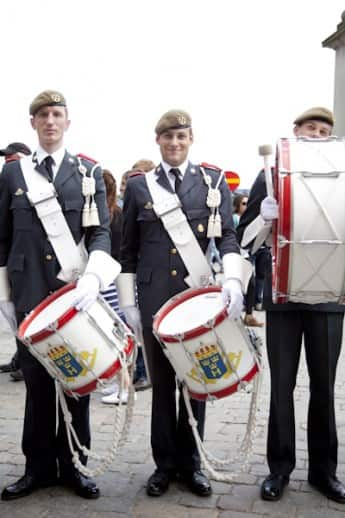 Members of a Swedish military band pose after a performance before the Royal Palace of Stockholm.