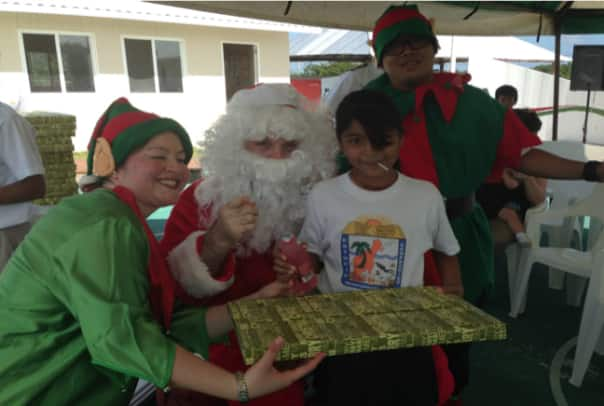From left: International Concierge Silvia Ascoy, Santa Claus (aka Jason  Andrew Brenner) and Culinary Clerk Ireneus Aditya.