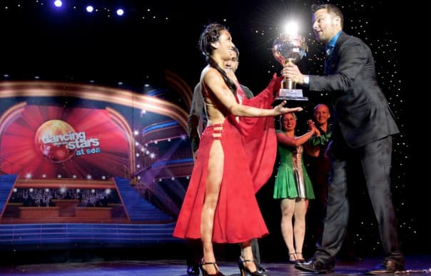 Champion Allyse Ishino accepts the Mirror Ball trophy following her win.