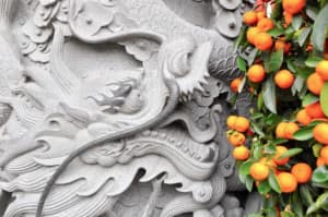 The entrance to the temple, a dragon eating oranges, at Lantau. Courtesy of Joanne Gardner.