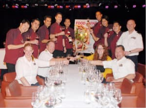 """""""Food and Wine"""" magazine Senior Wine Editor Megan Krigbaum, front, second from right, toasts with the officers and staff of Noordam."""
