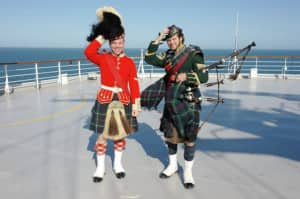 A Highlander and piper from the Halifax Citadel sail onboard cruises calling at Halifax. Photo: Parks Canada Halifax Citadel National Historic Site.