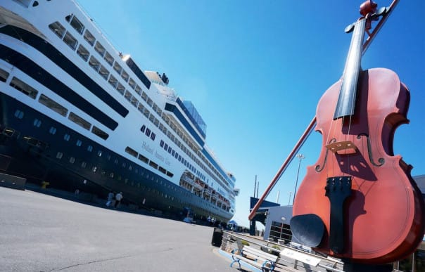The giant fiddle greets Veendam and its guests at Sydney, Nova Scotia.