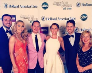 """HAL welcomes back """"Dancing with the Stars: At Sea"""" fan favorites, featured are (beginning second from left): Iveta Lukosiute, Carson Kressley, Kym Johnson and Tristan McManus with (far left) DWTS: At Sea Host Jason Venner and (far right) DWTS Producer Shauna O'Brien."""