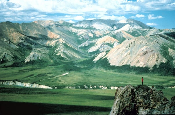 A lone hiker at the foothills of the Yukon.