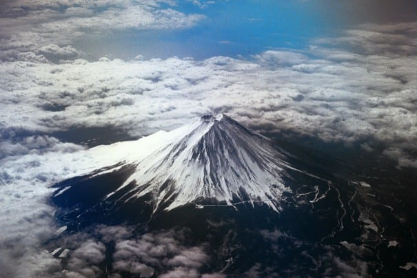Viewing Mt. Fuji from a boat is a highlight of the Hakone & Shinknasen High-Speed Train tour.