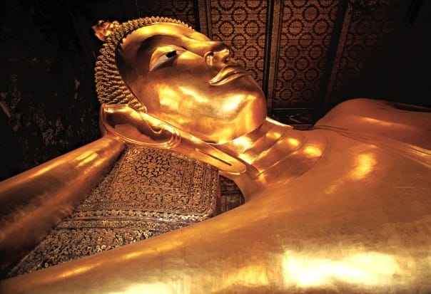 Admire the golden Reclining Buddha at Wat Po.