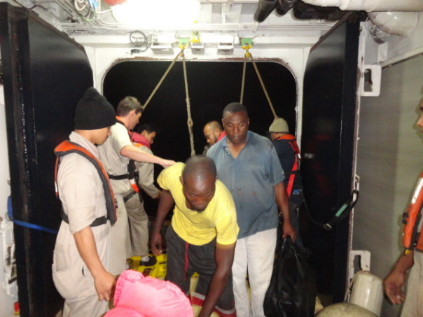 The eight crew members of Excalibur were taken onboard after their boat started to sink.