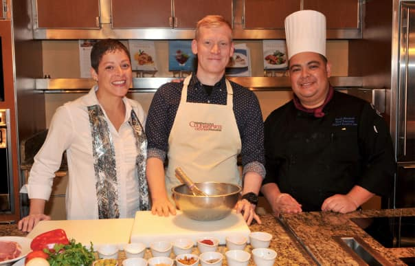 Food & Wine's Justin Chapple, center, with Culinary Arts Center Host Annette Montañez  and Chef Tournant David Menjivar.