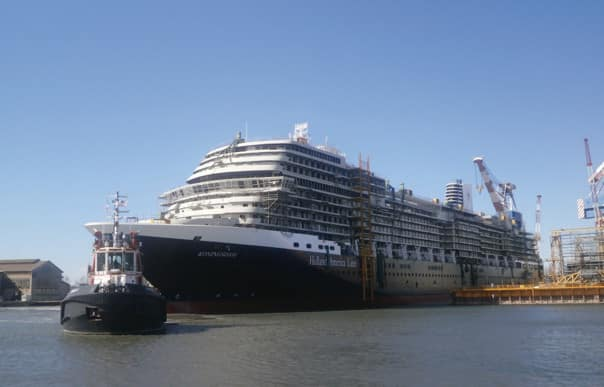 Koningsdam getting towed from the drydock to the outfitting dock.