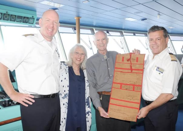 From left: Captain Jeroen van Donselaar, Nancy and Francis Stiles, and Hotel Director Simon Tanner display the historic tote bag.