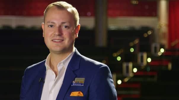 Koningsdam's Cruise Director Johnathan Rogers hosts Countdown to Koningsdam.