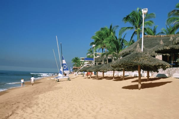 Guest can sink their toes into gorgeous golden sand at Mazatlan.