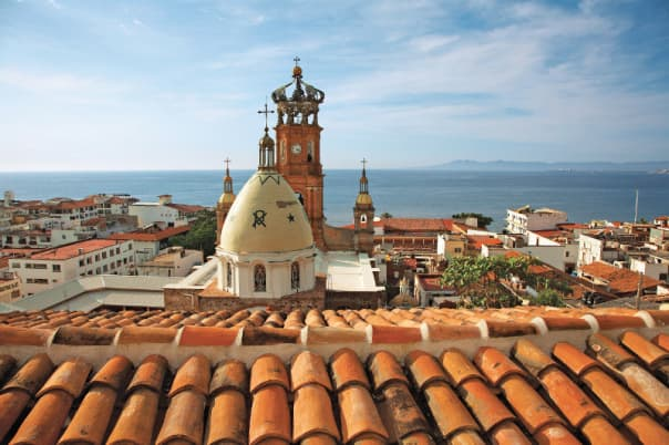 Red-tiled roofs give Puerto Vallarta a colorful skyline.