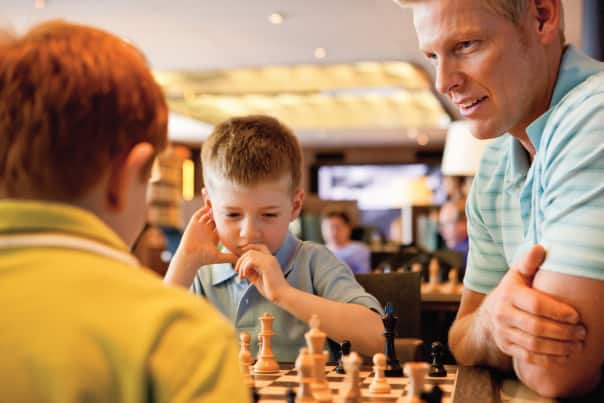 Enjoy a friendly chess match with family at the Explorers Café.