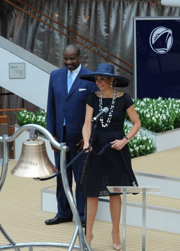 Queen Máxima ringing the ship's bell as Holland America Line President Orlando Ashford looks on.