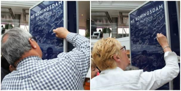 Cees and Yvon Kloppenburg sign Koningsdam's commemorative wall.