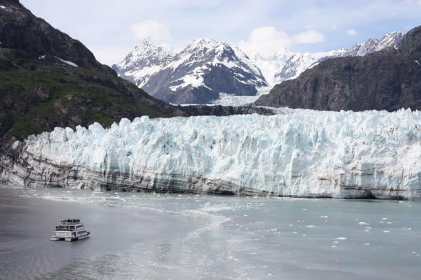 A sight-seeing boat shows the scale of the glacier.
