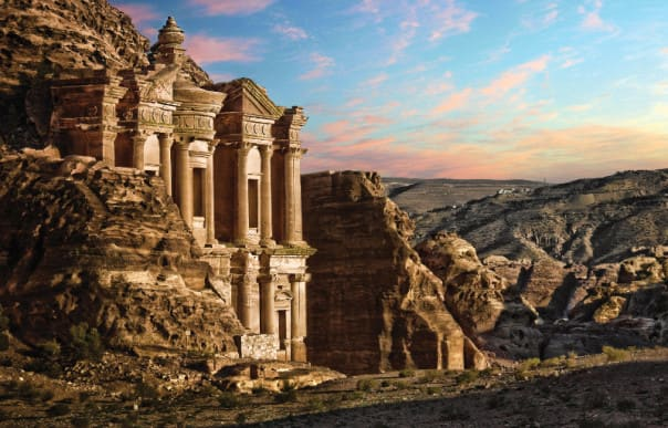 The Grand World Voyage features exceptional experiences, like visiting the mystical city of Petra in Jordan.