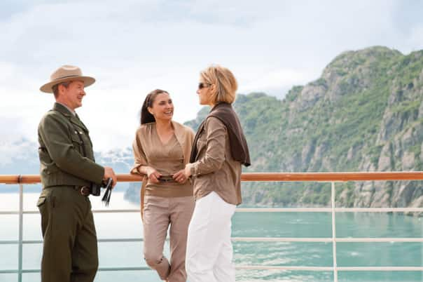 Chat with a Glacier Bay park ranger on deck during an Alaska cruise.